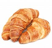 stock photo of carbohydrate  - Three fresh croissants isolated on white background