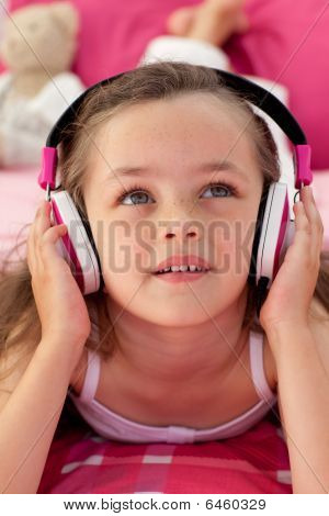 Close-up Of A Cute Girl Listening Music