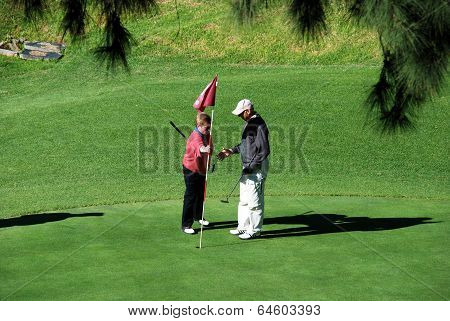 Golfers on green in Spain.