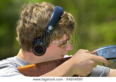 Boy Aiming Shotgun