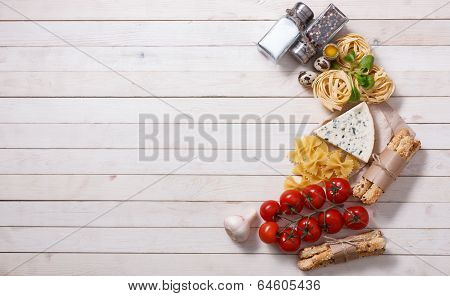 Overhead view of ingredients for an Italian pasta recipe on rust