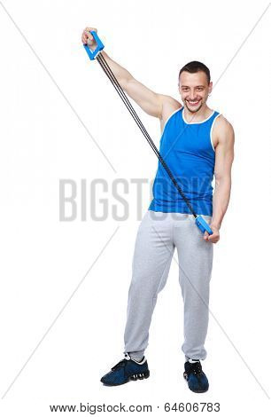 Full length portrait of a muscular sportsman with expanders over white background