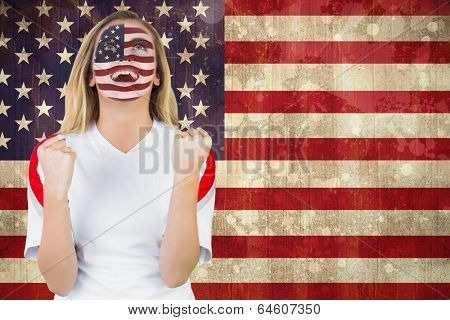 Excited fan in usa face paint cheering against usa flag in grunge effect