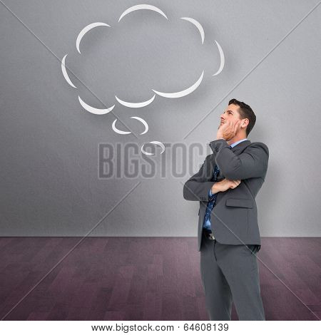 Thinking businessman against thought bubble