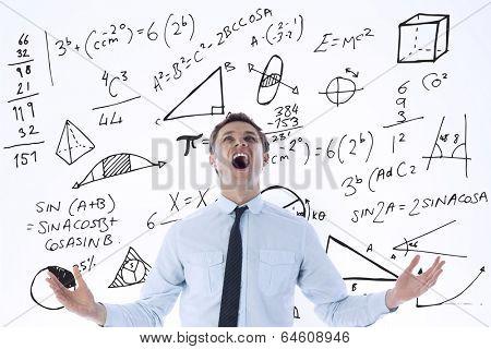 Shouting businessman against math equations