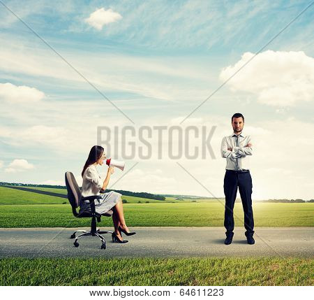 discontented young woman and serious calm man at outdoor