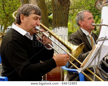 BUDYONNOVSK, STAVROPOL REGION, RUSSIA - MAY 1, 2014: trombonist from municipal brass band on the Labor Day celebration, on 1st of May 2014, in Budyonnovsk, Russia.
