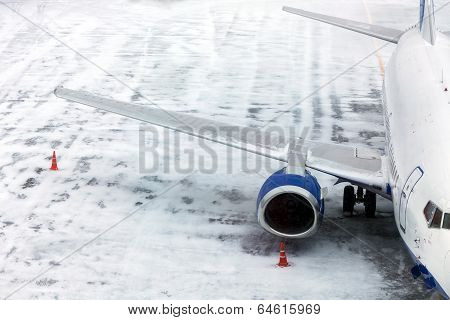 Passenger Airplane On Airfield Winter
