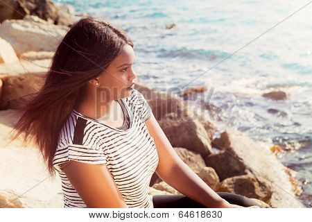 Young Girl Thinking By The Sea