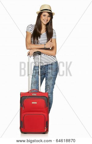 Woman tourist with suitcase