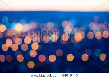 City Lights Big Abstract Circular Bokeh On Blue Background With Horizon
