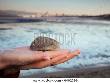 Rock held In Palm Of Woman's Hand