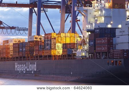 Hamburg - Container Vessel At Terminal In The Evening