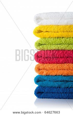 Stack Of Colorful Towels Isolated On White Background