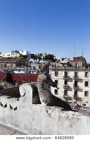 Rooftop view of Tangier, Morocco with sculpture of woman in foreground