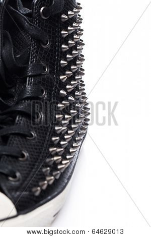Fashion. Black gumshoe on the white background