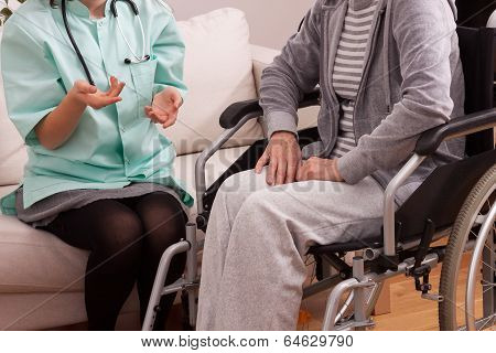 Nurse Talking With Disabled Patient
