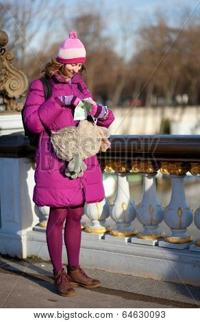 Happy Tourist Girl With Funny Bag And Map In Paris On The Pont Alexandre Iii