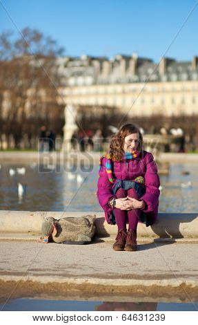 Pretty Young Girl In Bright Clothes In The Tuilleries Garden In Paris