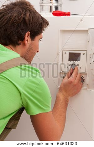Man Changing Temperature Setting