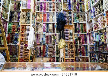 Shelves of colorful cotton reels in Tangier, Morocco