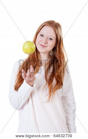 Redhead Girl Tossing An Apple