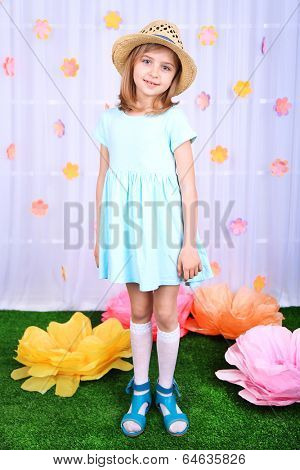 Beautiful small girl on decorative background