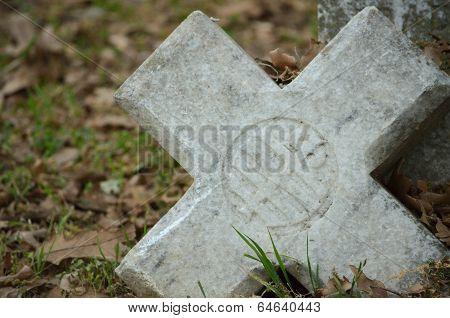 Broken Cross on Gravestone