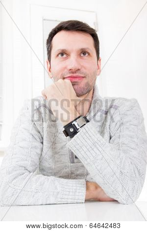 Portrait On A Nice Looking Handsome Casual Man Leaning On The Table