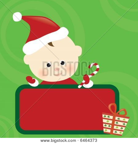 Christmas baby holding sign