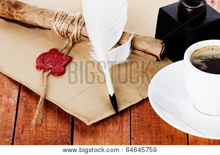 Cup Of Coffee With A Quill Pen And Inkwell Parchment Scroll On Wooden Background