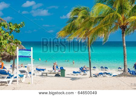 VARADERO,CUBA - APRIL 26,2014: People sunbathing at the beach on a beautiful sunny day