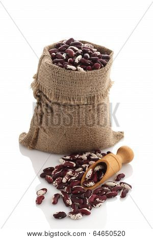 Speckled Kidney Beans In A Burlap Sack With Scoop