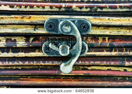 Little Iron Hasp On Wooden Background