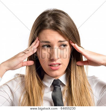 Cute Businesswoman With Headache Over Isolated White Background