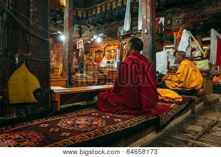 THIKSEY, INDIA - SEPTEMBER 4, 2011: Tibetan Buddhist monks during prayer in Thiksey gompa (Buddhist monastery)  of the Yellow Hat (Gelugpa) sect - the largest gompa in central Ladakh