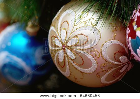 Beautiful color christmas decorations hanging on christmas tree with shiny glare