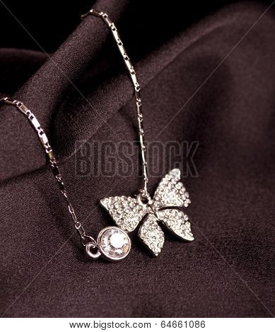 Beautiful jewelry in the form of a butterfly on a black background