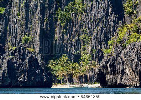 White beach and limestone cliffs in El Nido,  Philippines