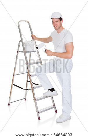 Painter With Paint Bucket And Roller