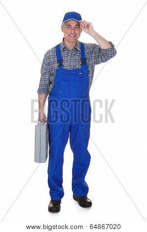 Mature Male Technician Holding Worktool