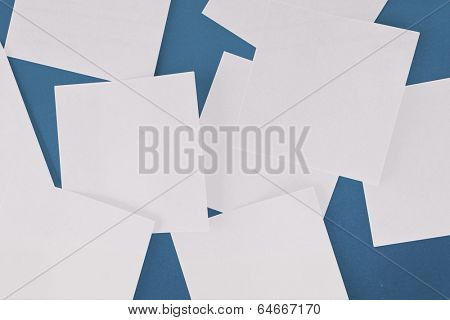 White paper strewn over blue surface