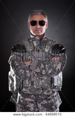 Portrait Of A Mature Soldier Wearing Sunglasses