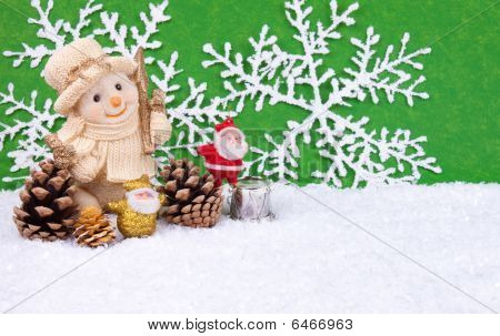 Santa Claus Figures And Snowman