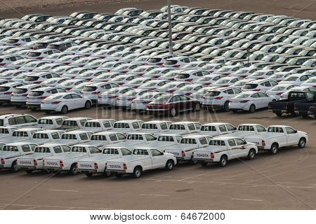 AQABA, JORDAN - MARCH 14, 2014: New cars on the holding yard. Hyundai and Toyota keep the leading position on the Jordanian new car market