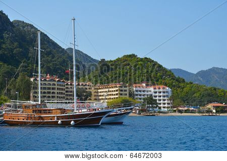 ICMELER, MUGLA PROVINCE, TURKEY - APRIL 2, 2014: Yachts against the hotels and mountains. The resort is targeted to tourists seeking a quieter alternative to the overdeveloped Marmaris