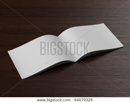 Open  brochure on a wooden table