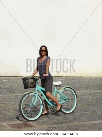 Woman With A Bicycle In A City