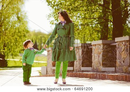 happy mother and her son spending time outdoor