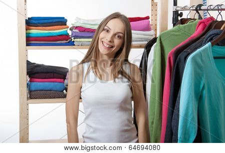 young woman chooses clothes, isolated on white background